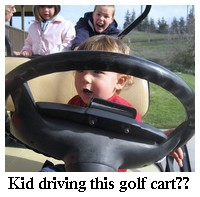 kids driving golf cart