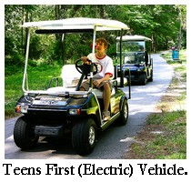 teens on golf carts, first electric vehicle