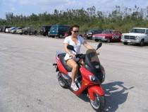 Woman riding Falcon EV Matrix