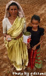 woman and daughter farming
